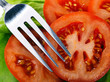 Tomato slices with fork
