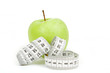 Measuring tape and green apples as a symbol of diet