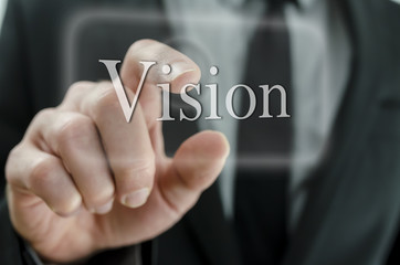 Business man pressing Vision button on a touch screen interface