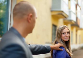 man stops a woman on street