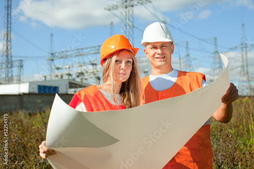 two workers at electric power plant
