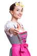 attraktive junge Frau im Dirndl mit Daumen-Hoch-Geste