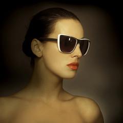 Beautiful woman in big violet fashion sunglasses.