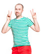 Portrait of a young cheerful man with v sign isolated on white