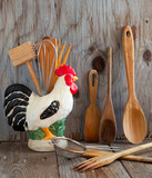 Kitchen cooking utensils: wooden spatulas, soons etc  on wooden