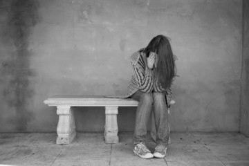 Lonely woman crying black and white
