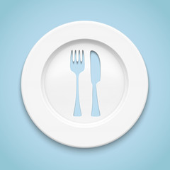 White plate with fork and knife cut.