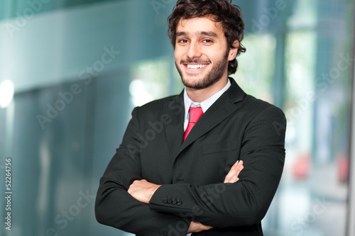 Handsome businessman in a modern office