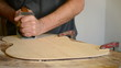 Luthier with Wood  planer  working  in  flamenco  guitar