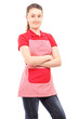 Smiling girl wearing an apron and looking at camera