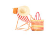 Sun lounger with orange stripes and summer accessories