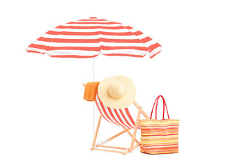 Sun lounger with orange stripes, umrella and summer accessories