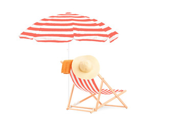 Sun lounger in stripes and umbrella