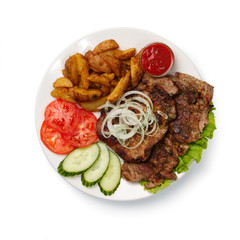 fried spare ribs with potatoes and vegetables