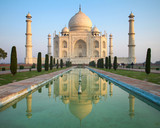 A perspective view on Taj Mahal mausoleum with reflection in wat