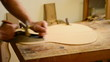 Luthier  working  in  a  guitar