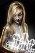 Fiber optics concept, future blonde dressed in silver