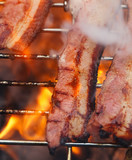 bacon meat on bbq  barbecue grill with fire