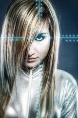 communications concept, young blonde with silver latex jumpsuit