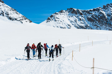 Group of Ski player walking on the snow into the mountain