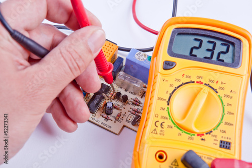 Testing board with digital multimeter