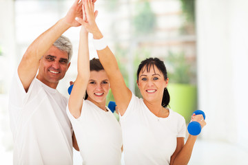 family doing high five after exercising