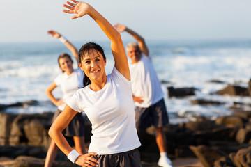 senior woman exercising with family