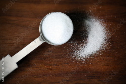 Baking soda or sodium bicarbonate in a tea spoon and dusted