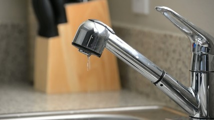 Close up of dripping kitchen sink faucet