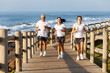 fit family jogging at the beach