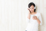 beautiful asian woman listening music
