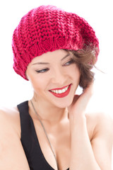 pretty smiling woman wearing pink hat
