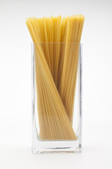 long spaghetti in a glass on...