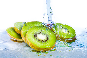 Isolated Kiwi with water splash