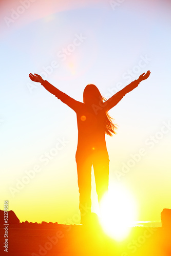 Happy cheering celebrating success woman sunset