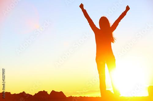 Leinwanddruck Bild Happy celebrating winning success woman sunset
