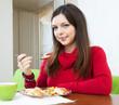 Brunette woman having dinner