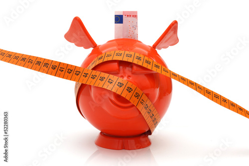 concept of no money with piggy bank and measuring tape