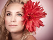 Blond girl with red flower