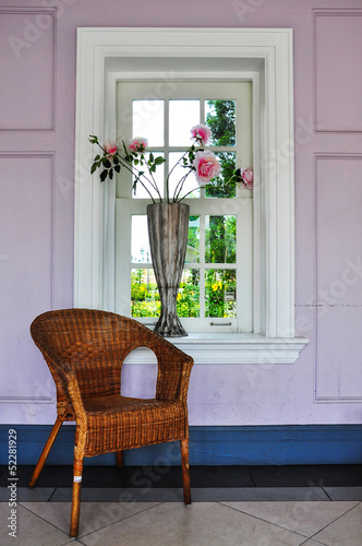 rattan chairs with vase and window