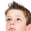 Macro portrait of Boy looking at corner.