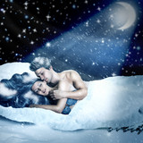Loving fairy couple in a bed of snow