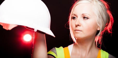 Young architect woman construction worker, safety helmet