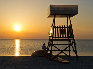 Lifeguard watchtower at sunset on the beach