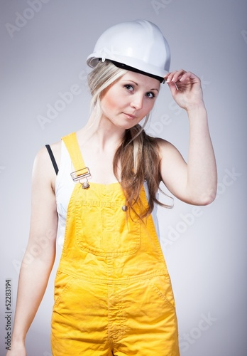 Young builder craftswoman, construction worker