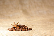 Coffee and Star Anise on sackcloth background with copyspace
