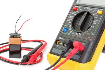 Electrical multimeter to check the resistance. On a white backgr