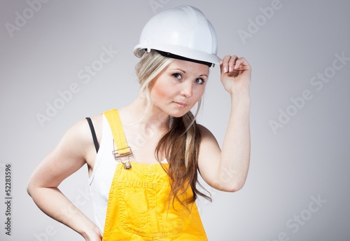 Young woman as a construction worker