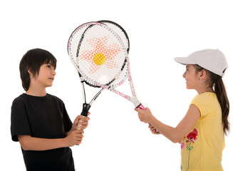 two happy children posing with tennis racquets on white backgrou