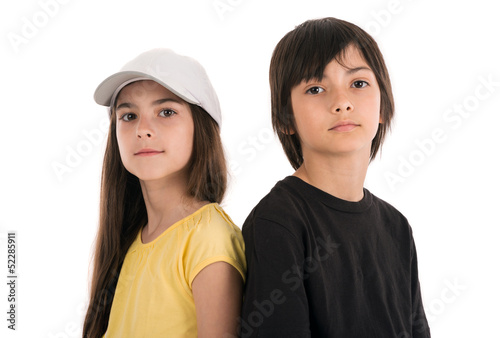 two children, boy and girl friends posing happily on white backg